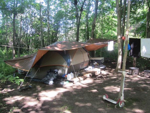 The tent site on Friday that was about 100 feet into the woods behind the parking lot of the Rockland Congregational Church and where a couple and three children were living.