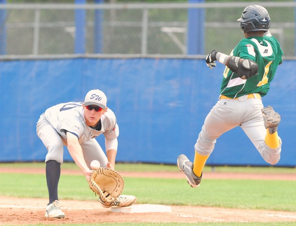 Texas' John Doxakis (20) fields the throw to first base on a close play with Latin America's Nathanael Makaya (11), who was called safe in first inning action during the Senior League World Series championship at Mansfield Stadium in Bangor on Saturday.