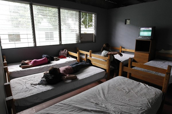 Unaccompanied minors watch TV at the Honduran Center for Returned Migrants after being deported from Mexico, in San Pedro Sula, northern Honduras on June 20, 2014.