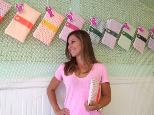 Alaina Marie Harris with her bait bags, made of maritime mesh, in her South Portland shop.