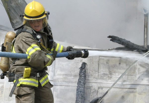 Lincoln firefighters including Donald Olson, seen battling a fire in August 2010, will train as part of a 10-department exercise on Sept. 6.