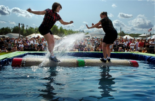 Allison Melton (left) of Bangor splashes Patty Marcum while the two compete in a log rolling competition during Timber Tina's Great Maine Lumberjack Show at the Blue Hill Fair on Sunday, Aug. 31, 2008.