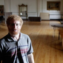 Michael Levine of Acorn Productions stands in the massive third floor ballroom in Mechanics Hall on Congress Street in Portland on Friday. The Maine Charitable Mechanics Association, the non-profit organization that owns and operates Mechanics Hall, is partnering with Acorn Productions in completing renovations to the third floor ballroom space so the venue can be licensed for public performances.