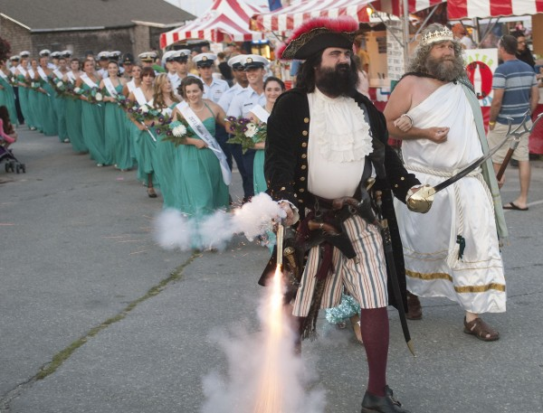 &quotBlackbeard&quot clears the way for King Poseidon and the Maine Sea Goddess candidates as they make their way to the throne at the 66th Annual Maine Lobster Festival on July 31, 2013, in Rockland.