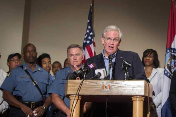 Missouri Gov. Jay Nixon declares a state of emergency and curfew in response to looting the previous night in Ferguson, Missouri, on Saturday.