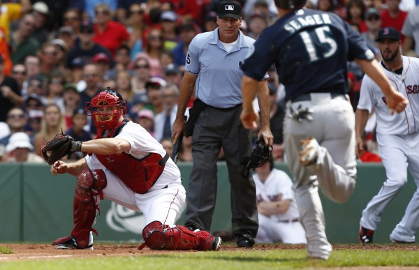 Boston Red Sox catcher David Ross (left) prepares to tag Seattle's Kyle Seager (15) at home plate during the second inning at Fenway Park in Boston Saturday.
