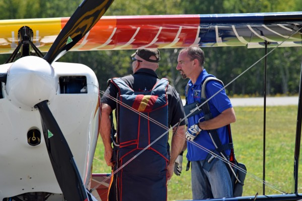 Iron Eagles stunt pilots Bill Gordon (left) and Billy Werth confer following their aerobatic performance at the Acadian Heritage Air Show in Frenchville on Sunday, Aug. 10. Werth suffered minor injuries after a crash landing in Standish later that evening, while returning home from the air show.