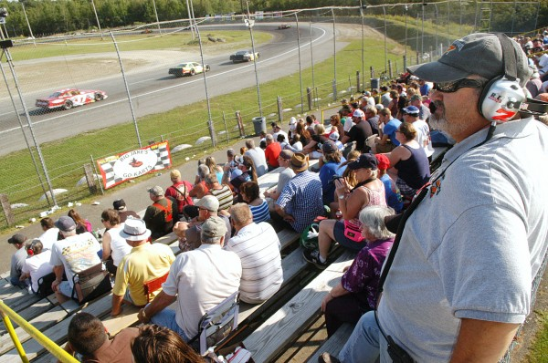 Kevin Alden (right), the spotter for Glen Luce's 7L car, follows the action from the stands Sunday during the Hight Chevrolet 150 at Speedway 95 in Hermon. BDN Photo By Terry Farren