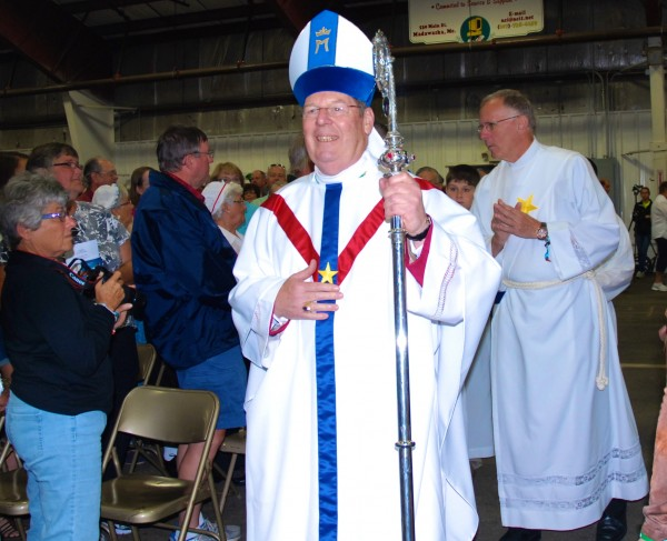Bishop Robert Deeley of the Diocese of Portland enters the Multipurpose Building in Madawaska for the Acadian Mass on Friday.