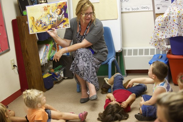 Kelley Watson, a preschool teacher at Penquis Head Start in Bangor reads a book to children in her class. Penquis has several ways of preparing children for kindergarden in Maine.