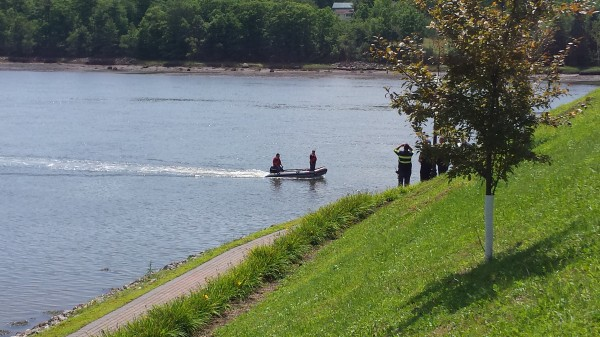 Rescue personnel search for a missing man along the banks of the Penobscot River by the Verona Island bridge early Friday afternoon.