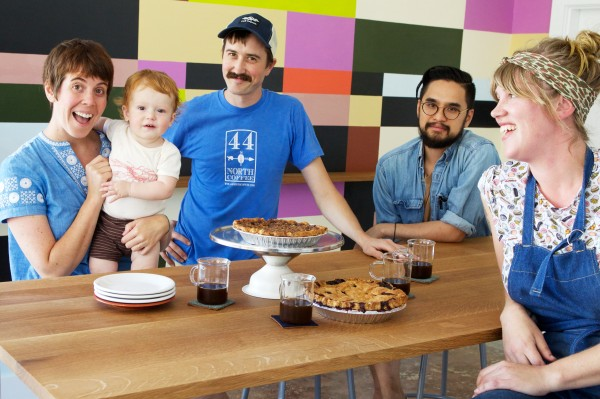 Co-owner Kathleen Pratt (left) coaxes a smile from son Claude for a Tandem Coffee team photo at their new Congress Street location in Portland on Monday. With Pratt is (from left) co-owner Will Pratt, managing partner Vien Dobui and baking manager Briana Holt.