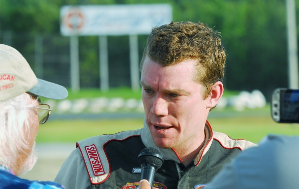 Cassius Clark, winner of the Hight Chevrolet 150 at Speedway 95, is interviewed by the race announcer Sunday in Hermon. Bangor Daily News Photo By Terry Farren
