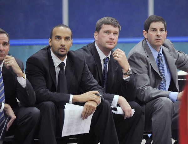 The University of Maine men's basketball coaching staff in 2009 included assistant coaches Chris Markwood (second left), Doug Leichner, and head coach Ted Woodward.