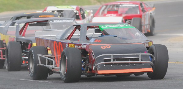 J.R. Barril (00) commands first position for the win in the Modified Class at Speedway 95 in Hermon on Sunday. BDN Photo By Terry Farren
