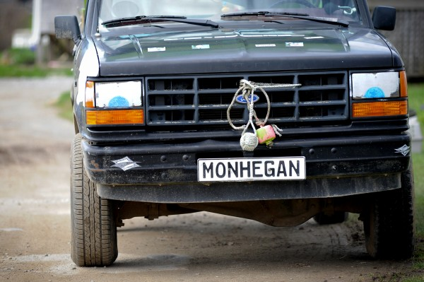 A decorated pickup truck on Monhegan Island, where most people don't have a vehicle, drives on the road in this May 2014 file photo.