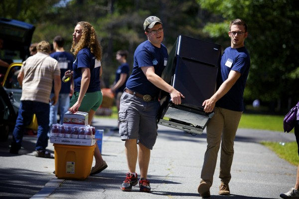 Gradeogh Cameron (left) and Robbie Fasano help move in a new student's refrigerator to Oxford Hall Friday afternoon during move in day at the University of Maine in Orono.