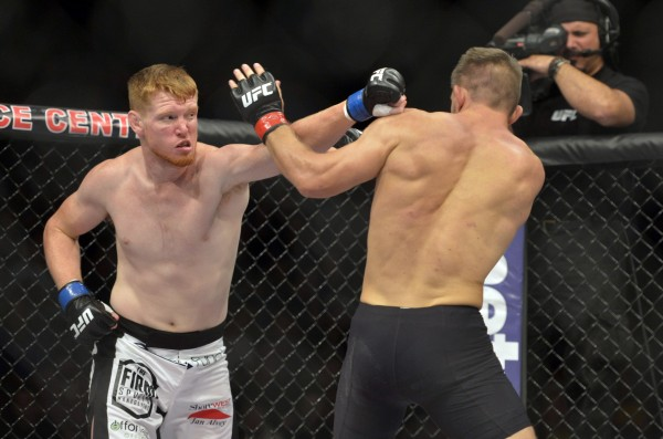 Tom Watson (red gloves) fights Sam Alvey during a middleweight bout in UFC Fight Night 47 at the Cross Insurance Center in Bangor Saturday night.