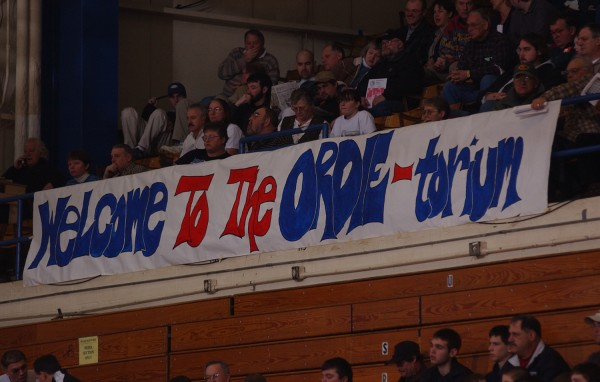 A sign proclaiming &quotwelcome to the Ordie-torium&quot is hung on the rail at the Bangor Auditorium during the the Jonesport-Beals Woodland game in this February 2003 file photo.