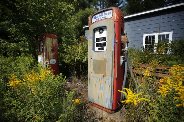 Nature is moving in on old gas pumps in Newry, Maine.