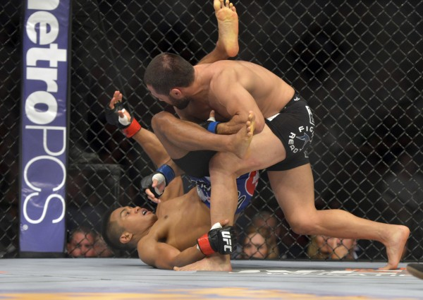 Nolan Ticman (red gloves) fights Frankie Saenz during a bantamweight bout during UFC Fight Night 47 at the Cross Insurance Center in Bangor Saturday night.