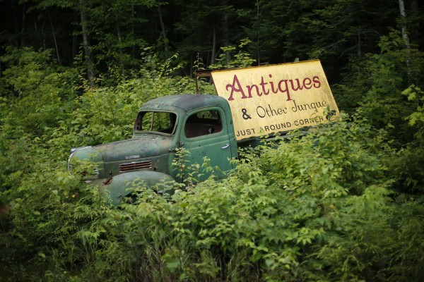 A truck made up of parts from three different makes of vehicles advertises an antique shop in Gilead, Maine.