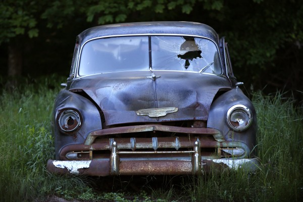 An old Chevy sits with a broken windshield in Waite, Maine.
