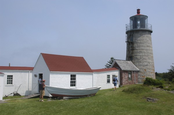 Tourists explore the grounds around Monhegan Island Lighthouse in this March 2012 file photo.