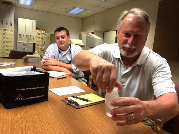 John Barry, plant manager for Plymouth-based Soil Preparation Inc., left, watches as Ted Johnston, the company's environmental consultant, demonstrate the n-butanol odor intensity scale the Maine Department of Environmental Protection will be using to determine if an odor is a nuisance.