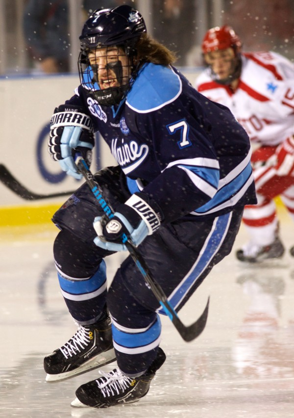 Suspended University of Maine hockey player Ryan Lomberg skates through wet spray on the ice at Fenway Park in Boston in this picture.