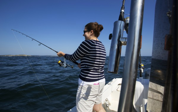 BDN's Sarah Walker Caron waits for a bite while on a fishing trip on Capt. Pete Douvarjo's boat on Tuesday in Sedgwick.