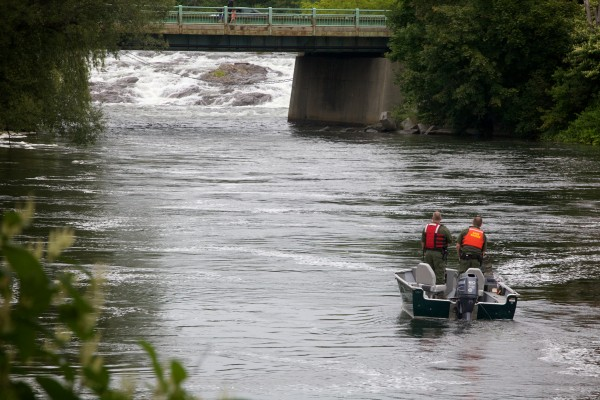 Maine Warden Service officials recover marker bouts below the fall on the Presumpscot River in Westbrook on Thursday after finding the body of a man.