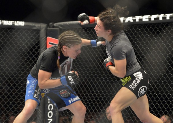 Sara McMann (red gloves) fights Lauren Murphy during a women's bantamweight bout in UFC Fight Night 47 at the Cross Insurance Center in Bangor Saturday night.