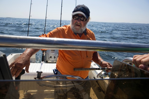 Capt. Pete Douvarjo navigates his boat to a spot where he believes BDN's John Holyoke, Sarah Walker Caron, and Caron's children will be able to catch many fish on Tuesday.