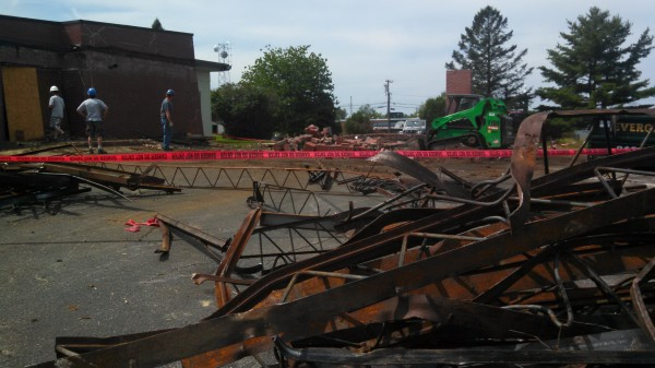 Crews have torn down the iconic carport over the entrance to the former Pilots Grill on Hammond Street in Bangor. Some took that as a sign that the building is being demolished, but that's not the case. A dance studio is moving into the building, which has been vacant for nearly two years. Owners say the carport was seriously damaged by ice and snow last winter.