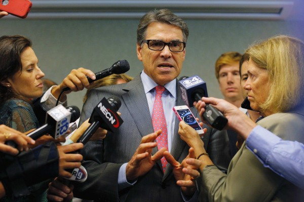 Texas Governor Rick Perry, a possible Republican candidate for the 2016 presidential race, answers questions from reporters following an appearance at a business leaders luncheon in Portsmouth, New Hampshire.