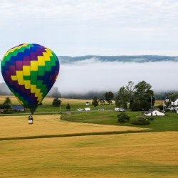 Mark Stodolski prepares to land Destination Unknown during the 11th annual Crown of Maine Balloon Fest in Presque Isle.