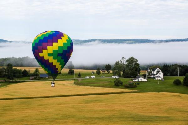 Mark Stodolski prepares to land Destination Unknown during the 11th annual Crown of Maine Balloon Fest in Presque Isle.