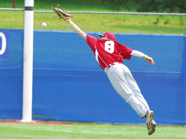 Maine District 3 center fielder Ryan Brookings comes up just short of catching a hard shot from a Texas batter during a Senior League World Series semifinal on Friday at Mansfield Stadium in Bangor.