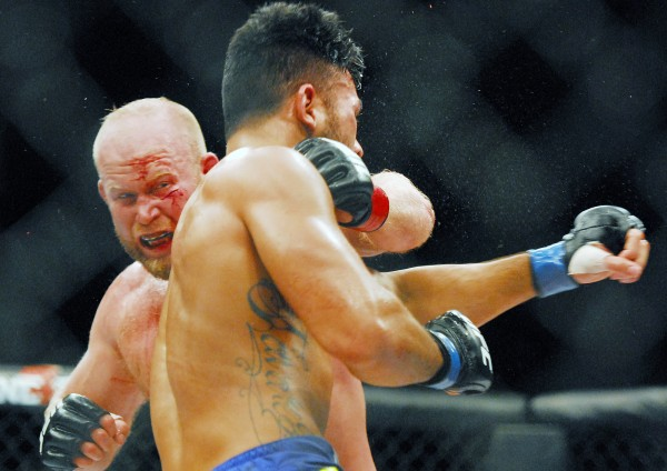 A bloody Tim Boetsch lands a punch on Brad Tavares and ends up knocking Tavares out Saturday night during the UFC Fights at the Cross Insurance Center in Bangor Saturday night.