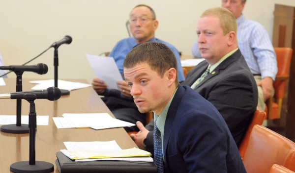 Ryan Thornell, executive director of the Board of Corrections (center), Chief Deputy Troy Morton (right) and Penobscot County Sheriff Glenn Ross spoke to the Penobscot County Commissioners about the projected budget shortfall of the Penobscot County Jail Tuesday in Bangor.
