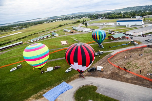 The last three of 12 balloons, (from left) Sinbad, Queen of Hearts and Windspirit, take off from the Presque Isle Fairgrounds during the 11th annual Crown of Maine Balloon Fest.