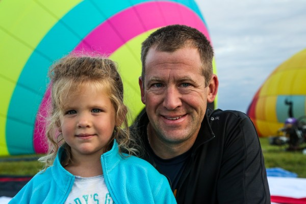 Dan Edgecomb (right) and his 4-year-old daughter, Olivia, were part of the inflation crew for pilot Wendell Purvis from Tallahassee, Florida, who flew the balloon &quotTracer&quot during the 11th annual Crown of Maine Balloon Fest in Presque Isle.