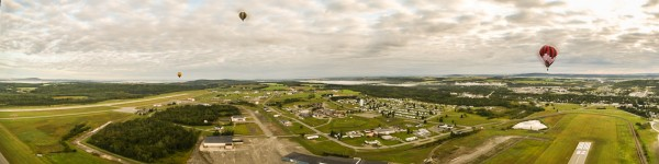 A panorama, comprising four photos, shows an aerial view of the Northern Maine Regional Airport at Presque Isle from Ron Cassidy's balloon, Double Exposure.