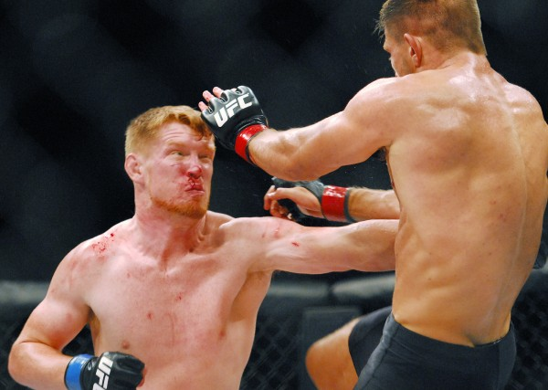 Sam Alvey (left) tries to land a punch on Tom Watson during the UFC fights at the Cross Insurance Center in Bangor Saturday night. Watson went on to defeat Alvey.