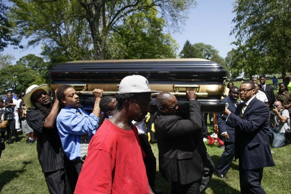 The casket containing the body of Michael Brown is carried to its final resting place in St. Peter's Cemetery located in St. Louis, Missouri, Aug. 25, 2014. Family and supporters on Monday celebrated the life of Michael Brown, a black teenager slain by police in Ferguson, Missouri, with a music-filled funeral service and calls to remember him with peace and political change. Brown's body lay at the Friendly Temple Missionary Baptist Church in a black and gold casket, topped with the St. Louis Cardinals baseball cap he was wearing when he was killed on Aug. 9 in nearby Ferguson by a white police officer.