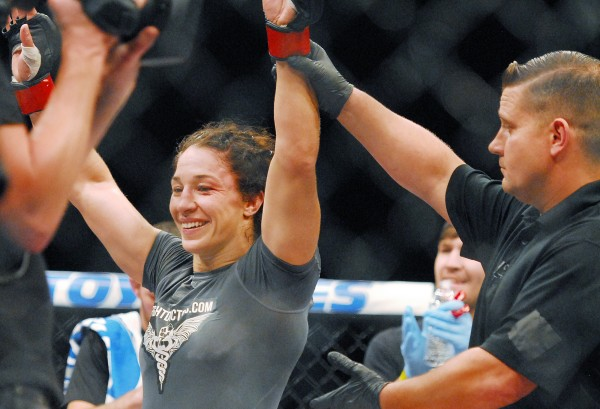 Sara McMann celebrates after defeating Lauren Murphy in the bantamweight division during the UFC fights at the Cross Insurance Center in Bangor Saturday night.