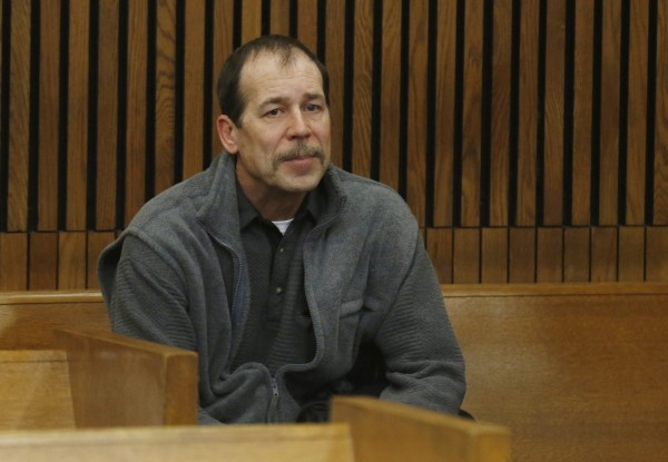 Theodore Wafer sits in the back of the court room before his arraignment in Detroit, Michigan, in this January 2014 file photo. He was found guilty of second-degree murder on Thursday.