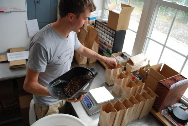 Will Pratt prepares Tandem Coffee Roasters coffee for shipment July 31 in Portland. He said the company still does a75 percent of its business wholesale, but will open a bakery and cafe at 742 Congress St. later this month.