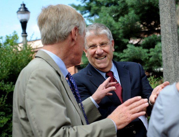 Eliot Cutler (right), an independent running for governor, laughs with Sen. Angus King before a press conference on Monday in Bangor, where King endorsed him for governor.